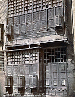 0120754 © Granger - Historical Picture ArchiveEGYPT: CAIRO.   The exterior of a building showing the typical wooden lattices over the windows, called 'meshrebeeyeh', in Cairo, Egypt. Photograph, mid or late 19th century.