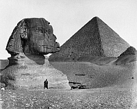 0129551 © Granger - Historical Picture ArchiveEGYPT: SPHINX AND PYRAMID.   A view of the Great Sphinx at Giza, Egypt, partially excavated, with a pyradmid shown in the background. Photographed by Felix Bonfils, c1875.