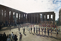 0129826 © Granger - Historical Picture ArchiveEGYPT: LUXOR TEMPLE.   Rowing crews from Harvard, Yale, Oxford, Cambridge, and Cairo University watch a reenactment of an ancient Egyptian ceremony while visiting the ruins of the Temple of Amon in Luxor, Egypt. Photographed c1975.