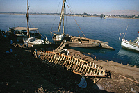 0129915 © Granger - Historical Picture ArchiveEGYPT: FELUCCAS.   Feluccas moored along the banks of the Nile River in Egypt, where the hull of another is under construction. Photographed c1975.