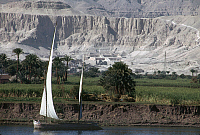 0129928 © Granger - Historical Picture ArchiveEGYPT: FELUCCAS ON THE NILE.   Feluccas moored along the banks of the Nile River in Egypt, near the ruins of the funerary temple of Queen Hatshepsut at Deir El Bahri, Thebes. Photographed c1974.