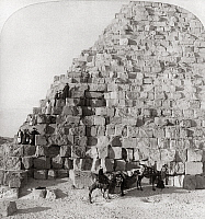 0260361 © Granger - Historical Picture ArchiveEGYPT: CHEOPS PYRAMID.   Group of tourists with guides on camels, climbing the Cheops Pyramid at Giza, Egypt. Stereograph, c1896.