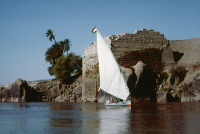 0354832 © Granger - Historical Picture ArchiveEGYPT: FELUCCA ON THE NILE.   A felucca with an old bridge in the background, on the Nile River at Aswan, Egypt. Photograph, c1970.