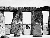 0077973 © Granger - Historical Picture ArchiveENGLAND: STONEHENGE.   Stonehenge on Salisbury Plain. Hele Stone seen through the entrance from the Altar Stone. Photograph, 20th century.