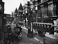 0094353 © Granger - Historical Picture ArchiveLONDON: GRIFFIN STATUE.   View of the Griffin statue on the Strand and Fleet Street, at the entrance to the City of London, England, from Westminster, with Law Courts at right. Photographed c1920.