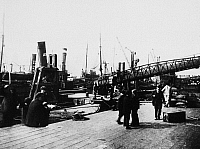 0094436 © Granger - Historical Picture ArchiveLONDON: BILLINGSGATE, c1915.   View of the wharf at Billingsgate, London, England, where fishing boats delivered their catch straight to market. Photographed c1915.