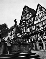 0118315 © Granger - Historical Picture ArchiveGERMANY: MILTENBERG.   Six story half-timbered houses on the market square in Miltenberg on the Rhine River in Germany, c1965.