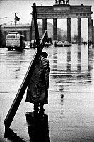 0118662 © Granger - Historical Picture ArchiveBERLIN: MAN AND CROSS, 1961.   A man carrying a cross on a street in West Berlin, near the Brandenburg Gate. Photographed by Tony Frissell, October 1961.