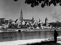 0166605 © Granger - Historical Picture ArchiveGERMANY: ULM, 1953.   A view of Ulm, Germany, on the Danube River, showing the Cathedral and the Metzgerturm (Butcher's Tower). Photographed by Eduard Renner, 1953.