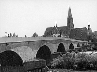 0166609 © Granger - Historical Picture ArchiveGERMANY: REGENSBURG.   A view of the Old Stone Bridge, dating from the 12th century, on the Danube River in Regensburg, Germany, looking towards the Cathedral of St. Peter. Photographed c1960.