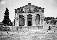 0118502 © Granger - Historical Picture ArchiveCHURCH OF THE AGONY.   Church of All Nations, the facade of the Roman Catholic church located on the Mount of Olives, next to the Garden of Gethsemane, East Jerusalem. It enshrines a section of bedrock where Jesus is said to have prayed before his arrest. Photograph, c1924.