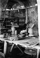 0130378 © Granger - Historical Picture ArchiveJERUSALEM: POTTERS.   Faience potters in Jerusalem shaping earthenware jars on a wheel. Photograph, early 20th century.