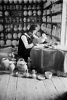 0130379 © Granger - Historical Picture ArchiveJERUSALEM: FAIENCE PAINTER.   A woman painting a faience vase at a workshop in Jerusalem, early 20th century.