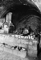 0130380 © Granger - Historical Picture ArchiveJERUSALEM: FAIENCE KILN.   Faience potters in Jerusalem prepare pots to be fired in the kiln. Photograph, early 20th century.