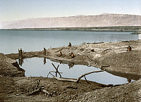 0173282 © Granger - Historical Picture ArchiveHOLY LAND: DEAD SEA.   Men standing on the shores of the Dead Sea. Postcard, c1895.