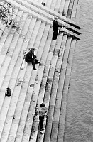 0167289 © Granger - Historical Picture ArchiveBUDAPEST: FISHING.   Two men and a boy fishing from a staircase on the edge of the Danube River in Budapest, Hungary. Photographed c1974.