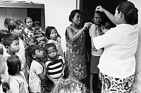 0125739 © Granger - Historical Picture ArchiveINDONESIA: BIRTH CONTROL.   A Balinese midwife instructs village women on the proper use of an intra-uterine loop device, 1972.