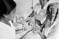 0125740 © Granger - Historical Picture ArchiveINDONESIA: BIRTH CONTROL.   A woman learns about the physiology of conception at a family planning clinic in the village of Pegu Jangen, 1972.