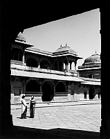 0118887 © Granger - Historical Picture ArchiveINDIA: FATEHPUR SIKRI.   Two women outside the Jodhabai's Palace in Fatehpur Sikri, India, founded by the Mughal emperor Akbar in 1569. Photograph, mid 20th century.