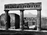 0095902 © Granger - Historical Picture ArchivePOMPEII: FORUM, c1900.   View of the Forum at Pompeii, Italy, with the ruins of a portico in the foreground and Mount Vesuvius seen in the distance. Photographed c1900.