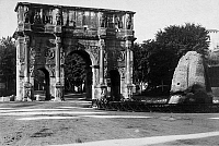 0095937 © Granger - Historical Picture ArchiveROME: ARCH OF CONSTANTINE.   View of the ruins of the Arch of Constantine in Rome, Italy, with the fountain known as the Sweating Meta at right. Photograph, early 20th century.