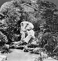 0127346 © Granger - Historical Picture ArchiveJAPAN: TEA GARDEN, c1906.   A Japanese woman and a western man in a tea garden in Japan. Stereograph, c1906.