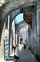 0129638 © Granger - Historical Picture ArchiveJERUSALEM: VIA DOLOROSA.   Site of the fifth station of the cross where, according to Christian tradition, Simon of Cyrene helped Christ carry his cross, on the Via Dolorosa in the Old City of Jerusalem. Hand-colored photograph, 20th century.