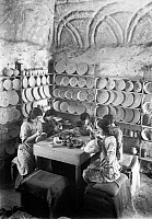 0130393 © Granger - Historical Picture ArchiveJERUSALEM: FAIENCE WORKSHOP.   Young women and girls painting faience vases and bowls at a workshop in Jerusalem. Photograph, early 20th century.