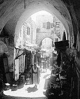 0130597 © Granger - Historical Picture ArchiveJERUSALEM: STREET.   A vendor-lined street in the Jewish Quarter of the Old City of Jerusalem. Photograph, early 20th century.