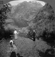 0326257 © Granger - Historical Picture ArchiveNORWAY: GEIRANGERFJORD.   Villagers raking hay in Geirangerfjord, Norway. Stereograph, early 20th century.