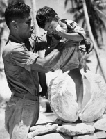0623288 © Granger - Historical Picture ArchiveBIKINI ATOLL: RESIDENT.   A native resident of Bikini Atoll in the Marshall Islands, holding a small child standing with one leg inside a clam shell. Photograph, 1946, before the island was evacuated for nuclear weapons tests by the United States.