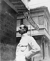 0125722 © Granger - Historical Picture ArchiveMANILA, c1900.   Unidentified man, probably an American officer, in front of the Manila Hotel, Manila, the Philippines, c1900.