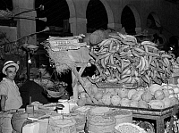 0123030 © Granger - Historical Picture ArchivePUERTO RICO: MARKET, 1942.   Bananas, coconuts, rice, beans and other produce for sale at the produce market in Rio Piedras, Puerto Rico. Photograph by Jack Delano, January 1942.
