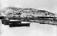 0119035 © Granger - Historical Picture ArchiveSPAIN: BARCELONA.   A view of the Barcelona harbor and a fort. Photograph, late 19th or early 20th century.