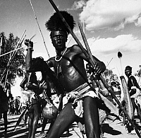 0131313 © Granger - Historical Picture ArchiveSUDAN: SHILLUK WARRIOR.   A Shilluk warrior, armed with spears and a club, performing a war dance near Malakal, Sudan. Photographed by Eliot Elisofon, 1947.