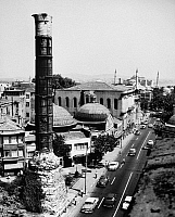 0133621 © Granger - Historical Picture ArchiveISTANBUL: PORPHYRY COLUMN.   The Porphyry Column of Constantine, dedicated in 330 A.D., with the Hagia Sophia in the background. Photograph, mid 20th century. RESTRICTED OUTSIDE US.