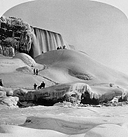 0117785 © Granger - Historical Picture ArchiveNIAGARA FALLS, c1900.   A view of Ice Mountain below Niagara Falls in winter, with visitors taking in the view. Stereograph, c1900.