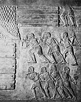 0175928 © Granger - Historical Picture ArchiveASSYRIA: WORKERS.   Workmen stacking wood on the shore. Detail from a relief in the palace of Sargon II, Khorsabad, Assyria, 8th century B.C.