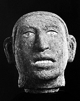 0165891 © Granger - Historical Picture ArchiveAZTEC: HEAD, 15TH CENTURY.  Basalt sculpture of a male head, with mother of pearl teeth and pyrite eyes. Aztec, 15th century.
