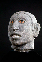 0165925 © Granger - Historical Picture ArchiveAZTEC: HEAD, 15TH CENTURY.  Basalt sculpture of a male head, with mother of pearl teeth and pyrite eyes. Aztec, 15th century.