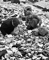 0266056 © Granger - Historical Picture ArchiveBERLIN, 1945.   Women searching for food in a garbage dump in Berlin, Germany. Photograph by Emil Reynolds, 1945.