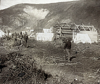 0111735 © Granger - Historical Picture ArchiveDAWSON CITY, c1897.   Log cabins and tents along the riverside at the gold mining town of Dawson City, Yukon Territory, Canada. Photograph, c1897.