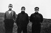 0113179 © Granger - Historical Picture ArchiveCANADA: FLU EPIDEMIC, 1918.   Three men from Alberta, Canada wearing masks, hoping to avoid contracting the Spanish flu, 1918.