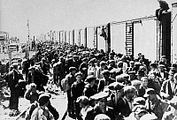 0118720 © Granger - Historical Picture ArchiveCANADA: UNEMPLOYED, 1935.   Unemployed men at a relief camp in Calgary, Alberta, in western Canada, preparing to board box cars destined for Ottawa, Ontario, to demand jobs at decent wages from the federal government, 10 June 1935.