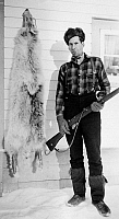 0118728 © Granger - Historical Picture ArchiveMOUNTY AND WOLF SKIN, c1943.   Constable James O. Brown of the Royal Canadian Mounted Police photographed next to the skin of a wolf which he had shot in front of the RCMP detachment at Fort Reliance, Northwest Territories, Canada, c1943.