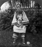 0105595 © Granger - Historical Picture ArchiveCHINA: LILY FOOD, c1905.   A 'lily footed' woman of China. Stereograph, c1905.