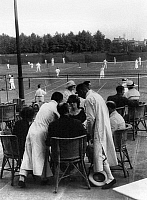 0114125 © Granger - Historical Picture ArchiveSHANGHAI: TENNIS CLUB.   Wealthy foreigners are waited on by Chinese servants at a tennis club in Shanghai. Photographed c1920.
