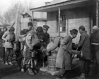 0115731 © Granger - Historical Picture ArchiveCHINA: FAMINE, c1909.   Chinese soldiers supervising the distribution of famine relief rations. Photograph, c1909.