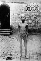 0115733 © Granger - Historical Picture ArchiveCHINA: FAMINE VICTIM.   Starving Chinese boy begging on the street. Photograph, early 20th century.