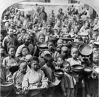 0115734 © Granger - Historical Picture ArchiveCHINA: PEKING, c1902.   Group of Chinese people waiting at the United States food distributing station in Peking, China. Stereograph, c1902.